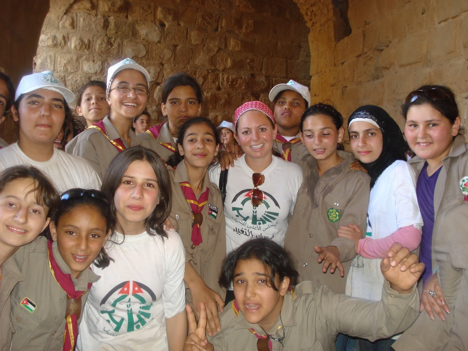 Allison standing with a group of children during her time in the Peace Corps in Jordan