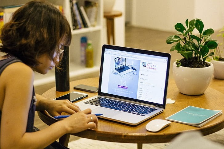 A woman working on her laptop at home