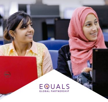 "Two women sitting in front of their computers and smiling. Below the image of the women is a white triangle with the words ""EQUALS Global Partnership"" written in purple"