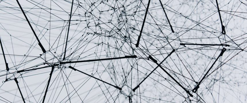A web of black lines connecting together to make geometric shapes on a white background
